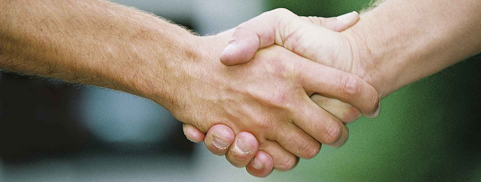 STRONG-HANDSHAKE cropped
